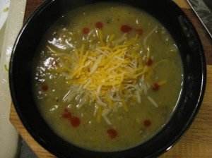 Soup with red pepper sauce and gluten-free cheese